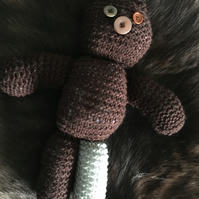 Hand knitted button-eye teddy bear
