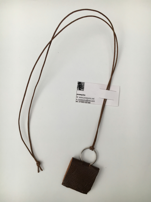 Handsewn leather pendant