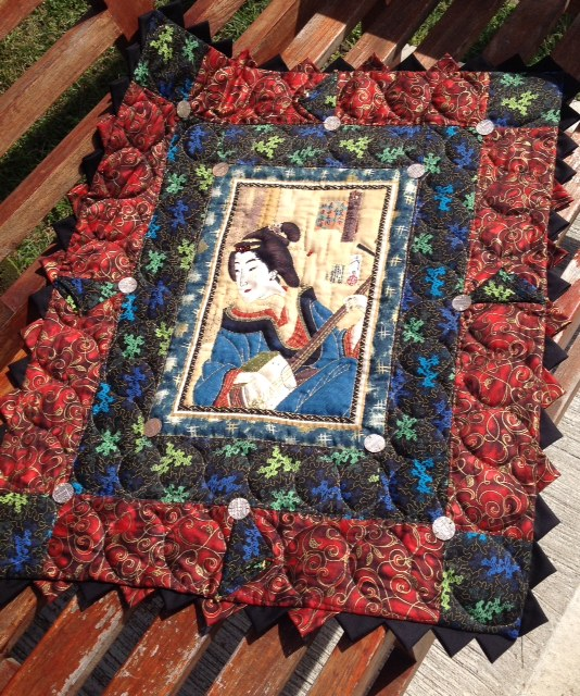Wall decoration. Oriental lady hand quilted