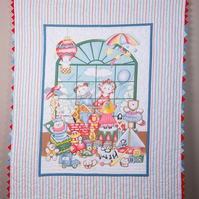 Baby cot quilt, hand quilted. (The Toy Shop)
