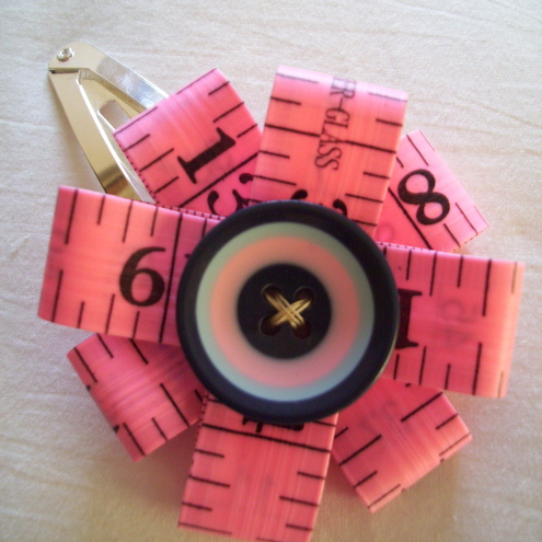Tape measure hair slide