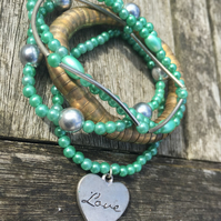 5 strand green and silver bracelet