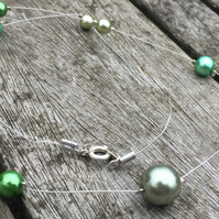 Green pearls illusion necklace