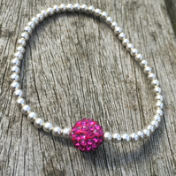 Elasticated silver plated metal beads and Fuchsia shamballa bead bracelet