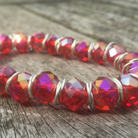 Red cut glass bracelet with silver jump rings