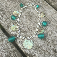 Green glass beads and shell bracelet