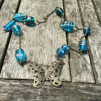 Blue glass beads and antique gold butterfly necklace