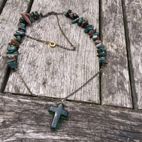 Green glass cross and cut stone antique gold necklace