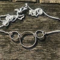 Silver plated twisted triple hoop necklace