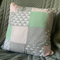 Grey, pink and green patterned patchwork cushion