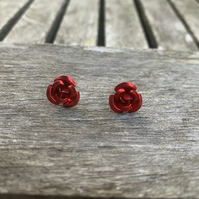 Red metal rose stud earrings