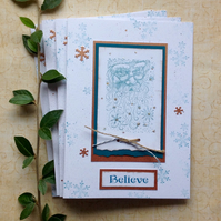 CHRISTMAS CARDS,( pack of 4, large ) Copper and teal . ' Believe '. Santa.