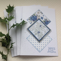 CHRISTMAS CARDS,( pack of 4, large ) Poinsettias . Blue and Silver.