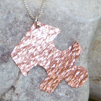 Jigsaw pendant in copper