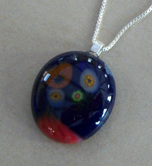 Blue glass pendant with sterling silver