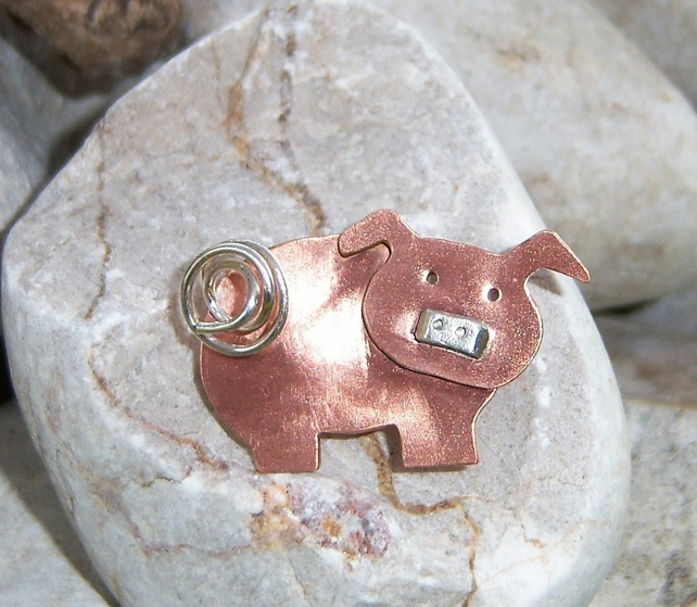 Copper pig brooch