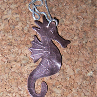 Seahorse pendant in etched copper