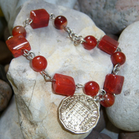 Bracelet with carnelian stones with 3d coin charm