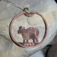 Sheep pendant cut from bronze penny coin