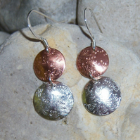Circle earrings in copper and sterling silver