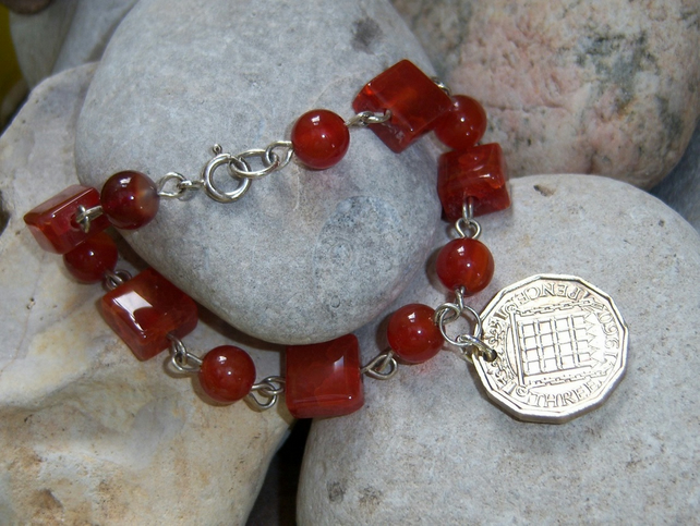 Bracelet with carnelian stones with recycled 3d coin charm