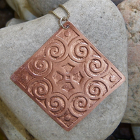 Statement pendant in etched copper