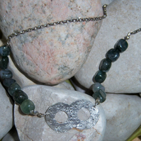 Infinity symbol in sterling silver with moss agate stones