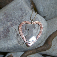 Dog and heart in sterling silver and copper