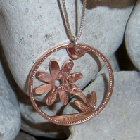 Flower pendant recycled from bronze penny coin