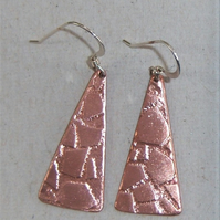 Earrings in copper with paving design