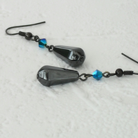 Hematite and crystal earrings, made with emerald crystal by Swarovski®