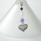 Pearl and tibetan silver heart charm necklace, with purple Swarovski elements