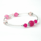 Pink gemstone and crystal bangle-style bracelet