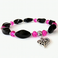 Black onyx bracelet with pink crystal and heart charm