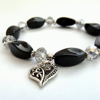 Black & silver stretchy bracelet, with heart charm