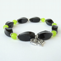 Handmade stretchy bracelet, with black onyx, green peridot & heart charm