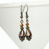 Bronze earrings with brown crystal