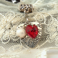 Tibetan silver charm necklace, with red Swarovski® heart crystal and pearl