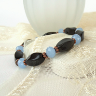 Gemstone and copper stretchy bracelet, with black onyx & blue crystal