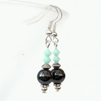Hematite earrings with mint alabaster crystals by Swarovski®