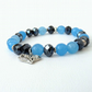 Stretchy blue gemstone and crystal bracelet with heart charm