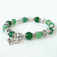 Green gemstone and crystal stretchy bracelet with heart charm embellishment