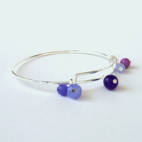 Expandable bangle-style bracelet, with mixed purple gemstones