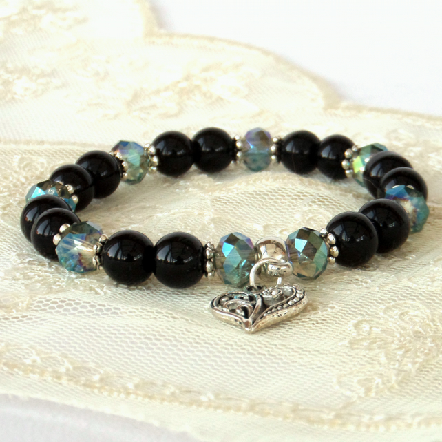 Stretchy black onyx and green crystal bracelet, with heart charm