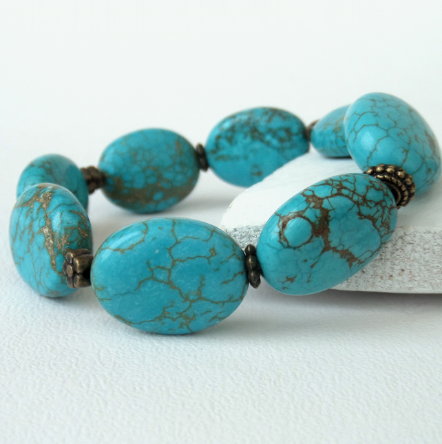 Turquoise coloured gemstonesand bronze handmade bracelet