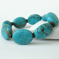 Turquoise coloured gemstone and bronze handmade bracelet
