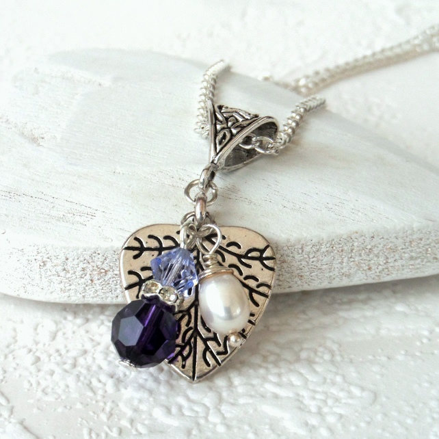 Charm necklace with pearl and purple crystal from Swarovski®