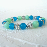 Handmade stretchy bracelet, with blue and pastel green jade