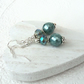 Teal green shell pearl and green crystal earrings