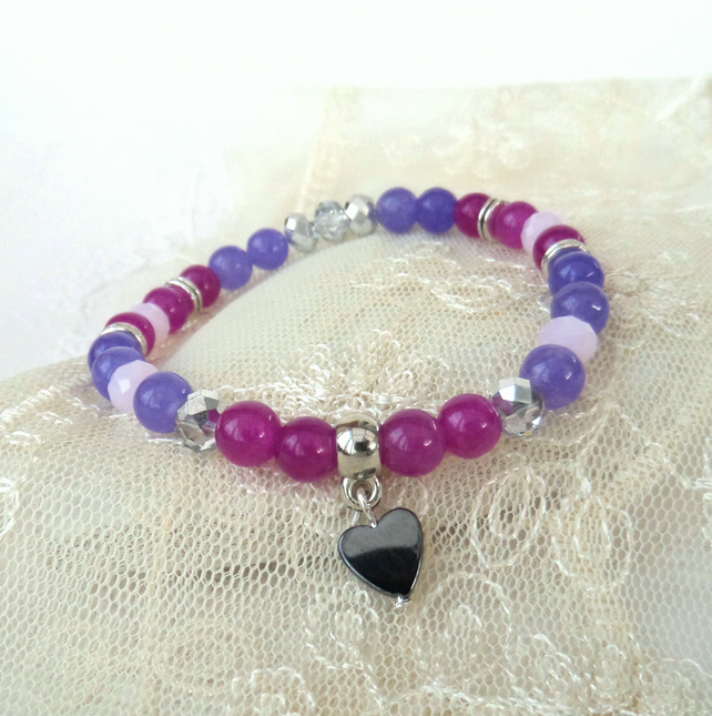 Purple and pink stretchy bracelet, with hematite heart charm